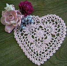 """Pink heart. Cebelia thread and a size 8 hook. I chained 4 (instead of 3)on the last round except for the 2 clusters on each side of the top """"V"""" of the heart."""