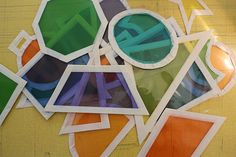 First, cut up colored dividers ($2 per package at the local K-mart) into shapes and line the borders with masking tape to make them durable. These are great for light exploration, color mixing, and shape identification.
