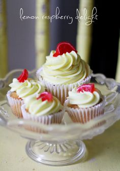 Lemon Raspberry Delight! A vanilla cupcake filled with raspberry filling and iced with a lemon butter cream icing and a raspberry slice!