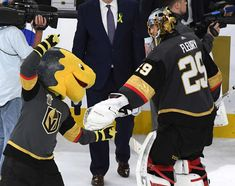 LAS VEGAS, NV - MAY 18: The Vegas Golden Knights mascot Chance the Golden Gila Monster points at Marc-Andre Fleury #29 of the Golden Knights after the team defeated the Winnipeg Jets 3-2 to win Game Four of the Western Conference Finals during the 2018 NHL Stanley Cup Playoffs at T-Mobile Arena on May 18, 2018 in Las Vegas, Nevada. (Photo by Ethan Miller/Getty Images)