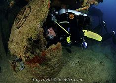 Scuba diver looking inside hatch on ship wreck USS Lamson, Bikini Atoll, Marshall Islands, Micronesia, Pacific