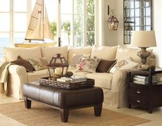 Liking the sofa, leather ottoman, and end table feel. Family room possibility...?