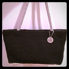Black Knit Purse from The Sak Black knit bag with touches of white and grey from The Sak.  EUC.  Double strap.  Zippered closure.  Beautifully made. The Sak Bags Shoulder Bags