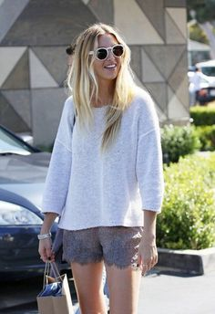 loose sweater and shorts