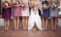 Use different color bridesmaid dresses but in uniform color pallets.