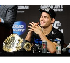 Chris Weidman sits with his newly won UFC middleweight belt in front of him at the post-fight press conference.