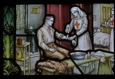 WW1 dressing station - a stained glass memorial created by the William Morris workshops for the parish church of Swaffham, Norfolk.