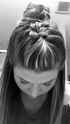 Cute inverse French braid into half up-messy bun.