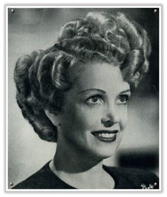 Veiled Haven - The Wedding Inspiration Blog: vintage hair: brushed out pin curls a la 1940s. (Crazy wave!)