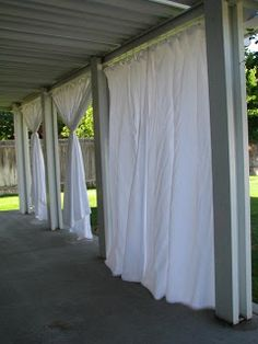 Considering doing this to one of my large covered patios. I would use cheap drop cloths. Outdoor Curtains Tutorial