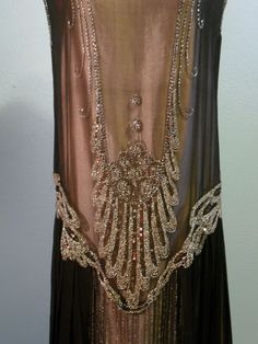 BEAUTIFUL BLACK SILK CHIFFON WITH THE TRADITIONAL 20'S DROP WAIST, DECORATED WITH SILVER SEQUINS, CLEAR SEED BEADS AND CLEAR SILVERED BUGLE BEADS
