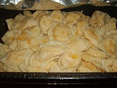 Pyrohi or Varenyky.  Ukrainian authentic recipe of these delicious cheese-potato-onion filled dumplings smothered in butter and onions.  YUM.