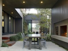 Contemporary Outdoor Patio by Jamie Bush & Co. This would be perfect with small river rocks on the ground. Home, House Exterior, Outdoor Dining, House Design, California Homes, Outdoor Decor, Outdoor Rooms, Beautiful Homes, Contemporary Outdoor