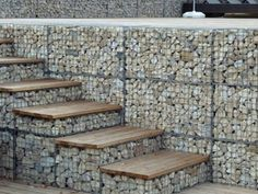 Gabion baskets are filled with rocks as steps and wall. Gabion baskets are filled with rocks as steps and wall. Gabion Stone, Gabion Retaining Wall, Gabion Fence Ideas, Retaining Wall With Steps, Fence Design, Garden Design, Gabion Wall Design, Gabion Baskets, Garden Stairs