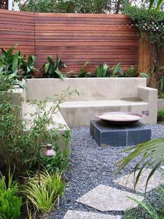 """The wood slat fence is made of ipe, a popular hardwood. The lower walls are masonry faced with smooth wall stucco. Most lumber yards carry ipe."""" """"Liking the idea of the horizontal wood"""" """"patio on east property line."""