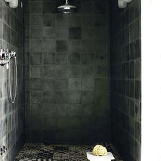 all black shower, black patterned flooring tile
