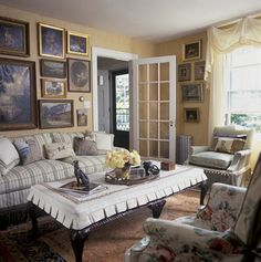 looks English--like the window treatment--not sure about the slip covered table.