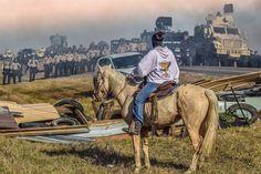 """Defend The Sacred"": Standing Rock, Cannon Ball, North Dakota, 2016  Photo credit: Ryan Vizzions"