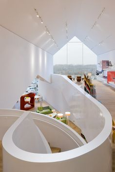 Frank Gehry's architectural practice developed this incredible office space for the Basel headquarters of Swiss furniture company Vitra. The office interiors are designed to allow for changeable workspaces employing Vitra's furniture, creating a wonderful working environment and a showcase of contemporary designer furnishings.