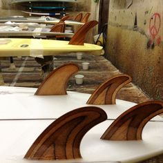 Gully's fin craftsmanship on several Almond surfboards, glassed on at Waterman's Guild