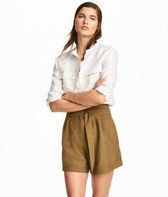 Check this out! Short, high-waisted, wide-cut shorts in woven fabric made from a modal blend. Pleats at top and zip fly with concealed hook-and-eye fastener. Side-seam pockets, welt back pockets, and attached belt with D-rings. - Visit hm.com to see more.