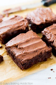 Thick, fudgy, chewy frosted homemade brownies made completely from scratch. You will never make a box mix again!!