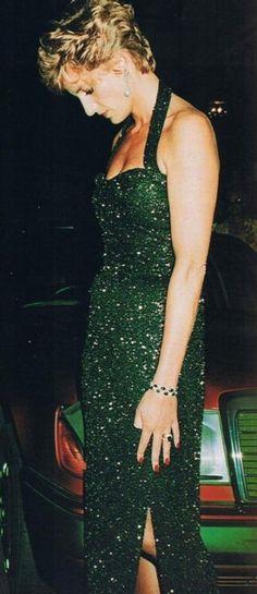 Princess Diana attending an event in Paris wearing emerald