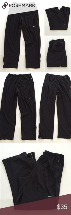 """[Nike] men's DRI-FIT athletic black track pants XL [Nike] men's DRI-FIT athletic black track pants XL •🆕listing •good pre-owned condition •black with screen insignia •length/inseam 30.5"""" •2 front zipper pockets, pant leg zippers •material 86% polyester 14% spandex, soft thin windbreaker feel •some wear to logo from washing •Offers welcomed using the offer feature or bundle for the best discount••• Nike Pants Sweatpants & Joggers"""