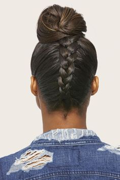 Up your top knot game with a back braid! Flip hair upside down and French braid the lower half of your hair in the back toward your crown, leaving out the front section. Once you reach the top of your head, gather the ends and the loose hair in front into a high pony. Secure with an elastic, then pin into a bun.