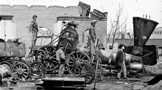 """""""Richmond, Va. Crippled locomotive, Richmond & Petersburg Railroad depot,"""" c. 1865 War brought destruction across the South. Governmental and private buildings, communication systems, the economy, and transportation infrastructure were all..."""