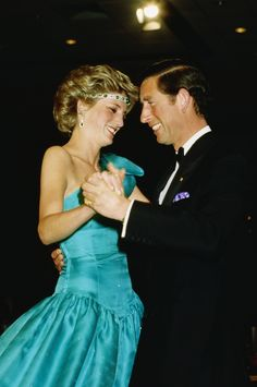 One of the few photos of both of them looking happy together. Princess Diana and Prince Charles