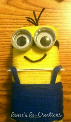Despicable Me minion. Recycled kid's craft. Yarn-wrapped Danon yogurt containers, Coke plastic bottle caps, and Dollar Store googly eyes.