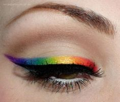 Lid Primer. Neutral Shadow on lid. Soft Cool-tone Brown on crease. Rainbow colored shadows, applied wet, gradually applied to lid. Thin black liquid liner. White tight line. Lots of black mascara. Glitter on bottom lashes. The end :)