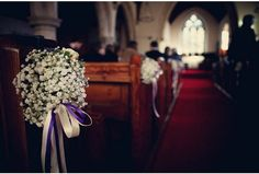 church pew flowers, but with lace bow rather than ribbon