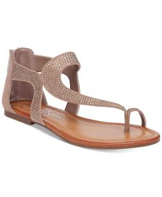Jessica Simpson's Kaarna sandals feature an asymmetrical, T-strap design with added sparkle for a unique twist on the popular gladiator style. | Manmade upper; manmade sole | Imported | Round open-toe