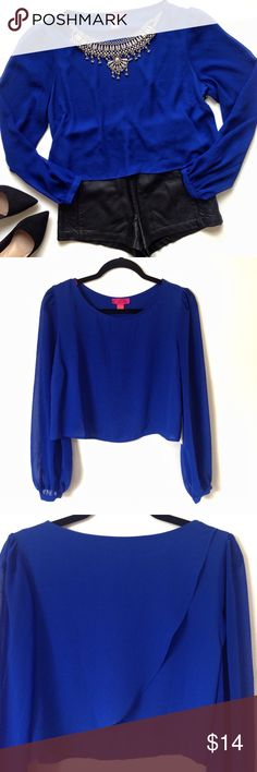 ✨SALE✨ NWT Royal Blue Tulip Back Crop Top This beautiful long sleeve blouse comes in royal blue and features sheer sleeves with buttons in cuffs, crop top silhouette and a tulip back. Unlined, sheer. NWT, excellent condition. 100% Polyester. Forever 21 Tops