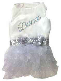 Dance the night away with this Magic Dance Dress. This dress is made of white satin on the back and white jersey on the belly for ultimate comfort and style. A super sparkly waistband made of silver sequence and a matching bow really make it special.