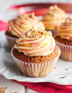 These rhubarb and custard cupcakes are filled with a tangy rhubarb puree and topped with a swirl of custard buttercream, rhubarb syrup and crunchy crumbs! Rhubarb Recipes, Rhubarb Cupcakes Recipe, Cupcake Recipes, Cupcake Cakes, Vanilla Cupcakes, Baby Cakes, Fruit Recipes, Mini Cakes, Recipies