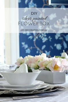DIY Silver painted flower box table centrepiece.  Turn a plain old box into something special with a bit of spray paint.
