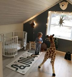 Toddler Room with Stokke Sleepi Bed and Dark Accent Wall and Dormers