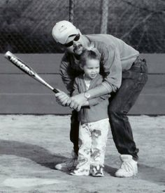 Teaching Lauren to play baseball