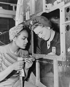Women building aircraft for WWII, early 1940s.