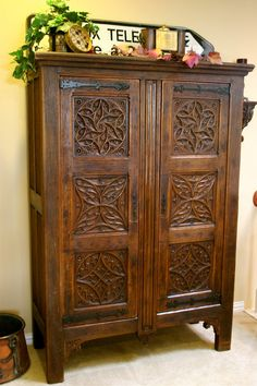 Rare Gothic Press Cupboard of solid English Oak with six ornately carved Celtic symbols