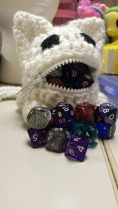 Adopt your very own! Dice Monsters are fuzzy dice-eating companions. Each adorable little monster has an appetite for about 50 dice at a time. Too much feeding makes their tummy hurt, so be sure not to feed past 'snug'. Each Dice Monster is lovingly raised by hand at the Dice
