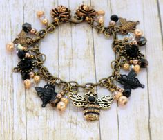 SALE Antique brass and black rhinestone bumblebee and flower