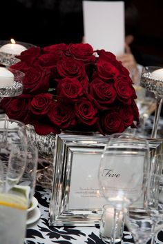 Red Rose Wedding reception table; similar to this it was beautiful :)
