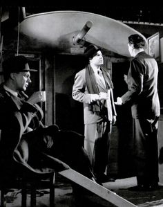 """Orson Welles, director Carol Reed (right), and Joseph Cotten (seated, left) have tea on the set of """"The Third Man"""" before recording the cuckoo clock speech, 1949"""