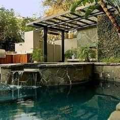 Celebrity Swimming Pools | Actor Channing Tatum's Laurel Canyon home is a modest 2,538-square-foot house that looks more like a Balinese tree house than a celebrity manse. With floor-to-ceiling windows and wraparound terraces, the secluded backyard boasts a bluestone slate patio, outdoor kitchen, and free-form swimming pool.