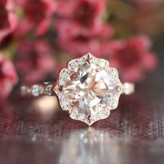 This vintage inspired morganite engagement ring features a 8x8mm cushion cut natural pinkish peach morganite crafted in a solid 14k rose gold floral