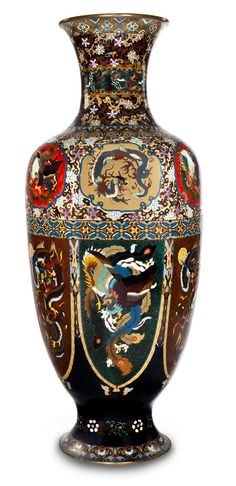 A monumental cloisonné enamel vase Meiji period (late 19th century) Of elongated ovoid form with faceted sides, set on a splayed foot and with tall flaring mouth, worked in polychrome enamels, aventurine and silver wires, the shoulder decorated with barbed cartouches of dragons and phoenix and the body with a band of large lappets containing alternating dragons and phoenix, the surrounding areas designed with densely decorated foliate scrolls, floral lozenges and cranes in clouds, copper…